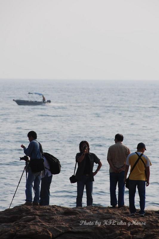 Photographer rock sea boat