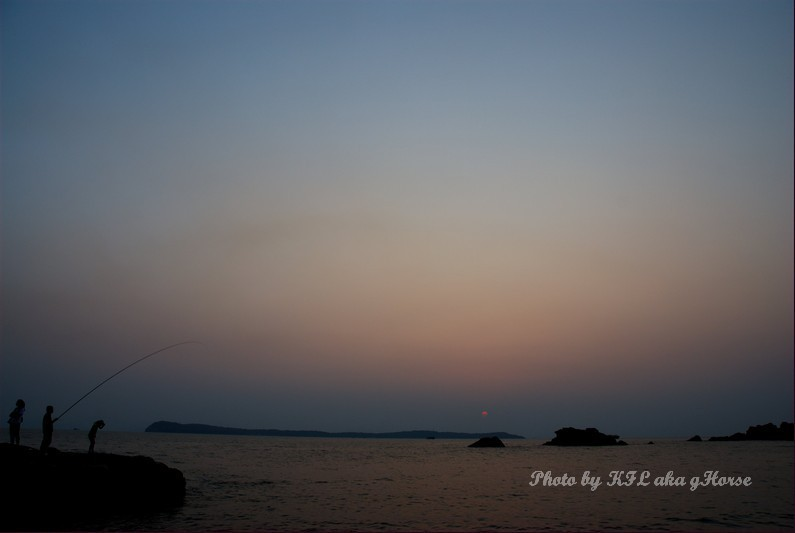 sunset sea rock fishing sky water