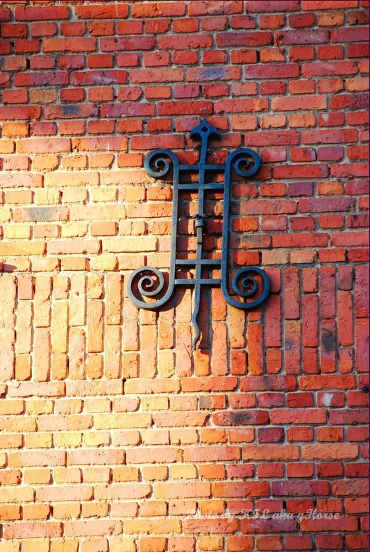 leuven belgium brick wall iron decoration