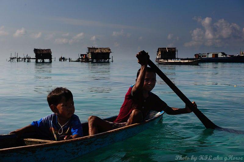 Semporna, Malaysia, sea, boat, children, house