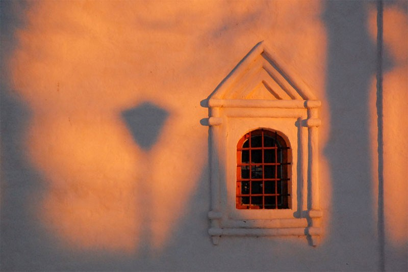 Senset shadows on the church's wall
