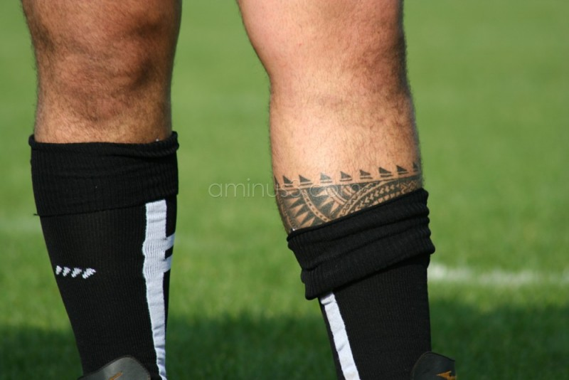 The tattoo on the rugby captain's leg