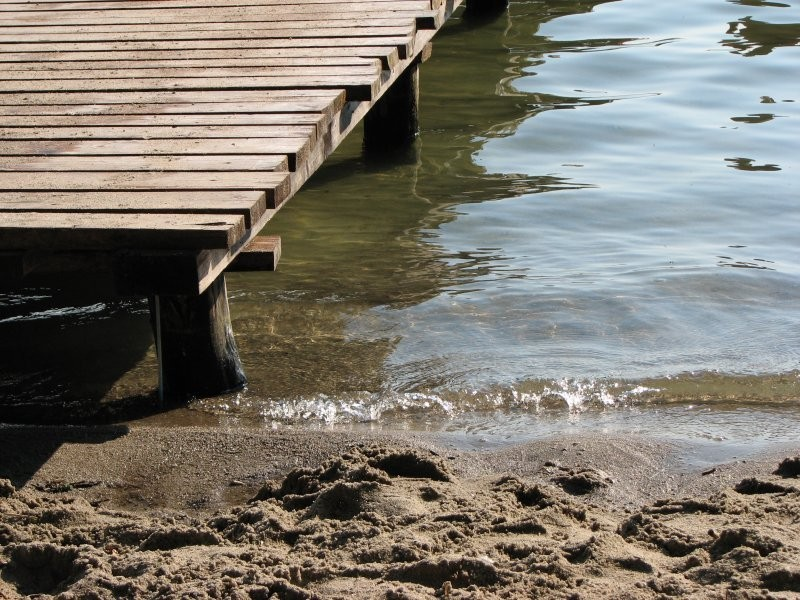 Water, sand and pier