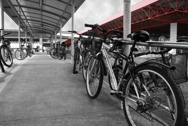 Train station, bicycles and shelter from the rain.