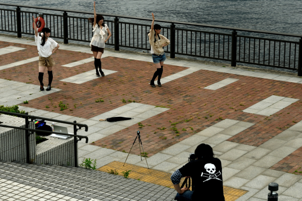 Would-be idols rehearse their moves by Tokyo Bay
