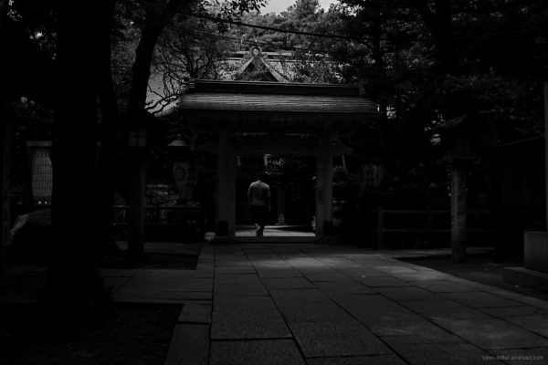 Shrine visitor pays his respects at Atago Shrine.