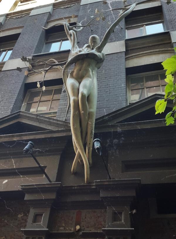 statue  entangled woman man