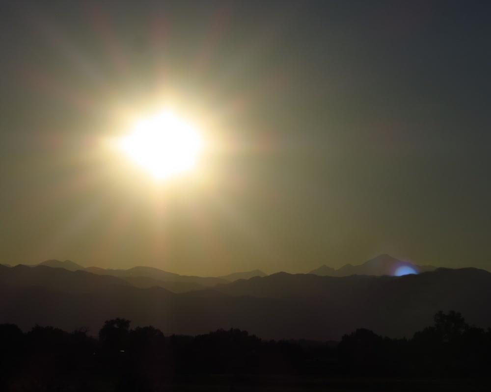 Mountain sun blue flash