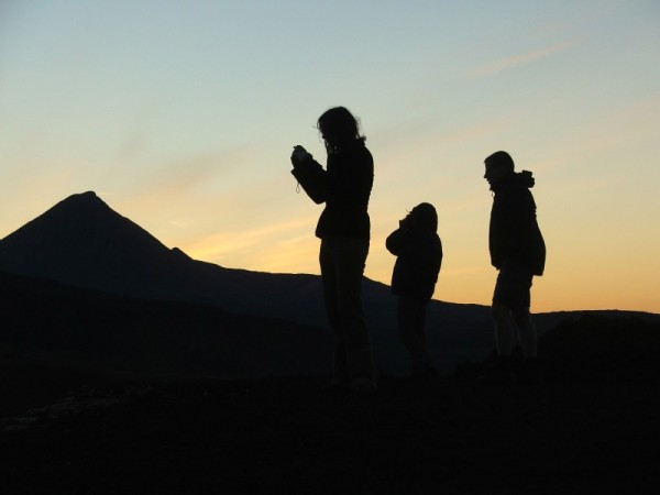 people silhouettes at sunrise