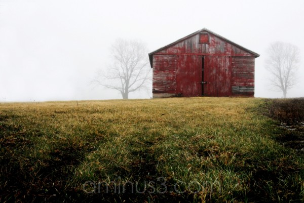 red barn in fog