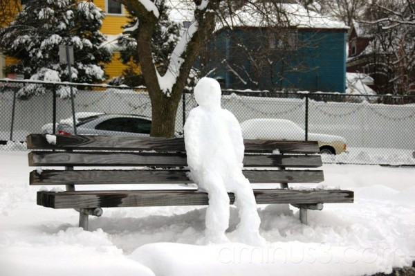 snow man sitting on bench cambridge massachusetts