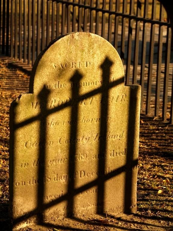 shadows on the tombstone