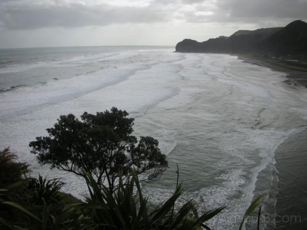 Grey cloudy day at Piha Beach