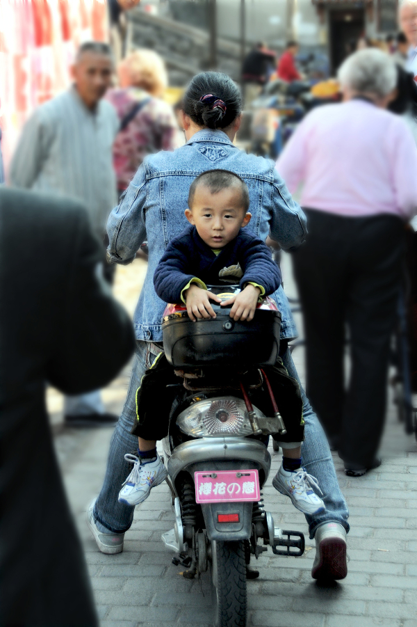 Mother and child in motorcycle