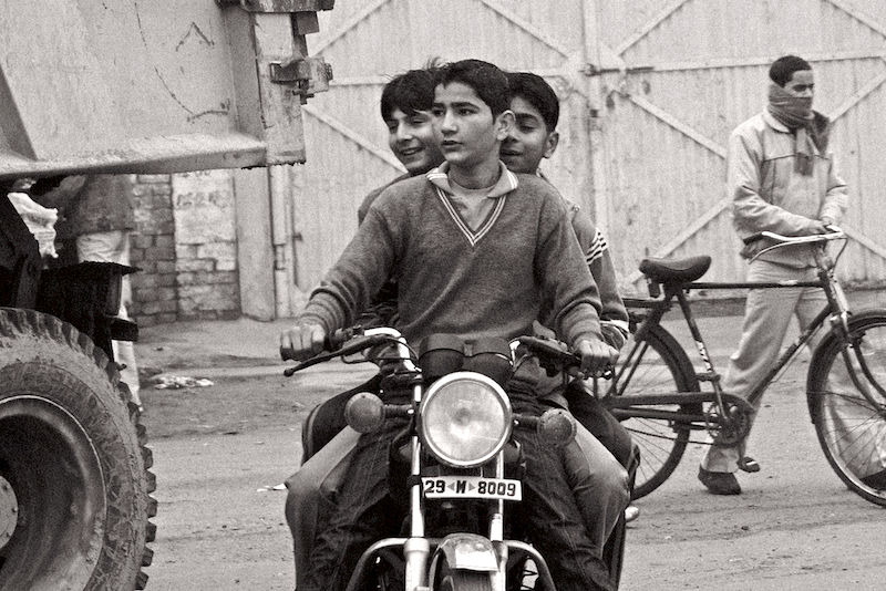 Three on Motorcycle in India