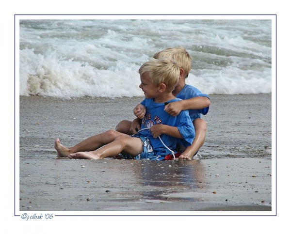 Two adorable brothers on the beach...