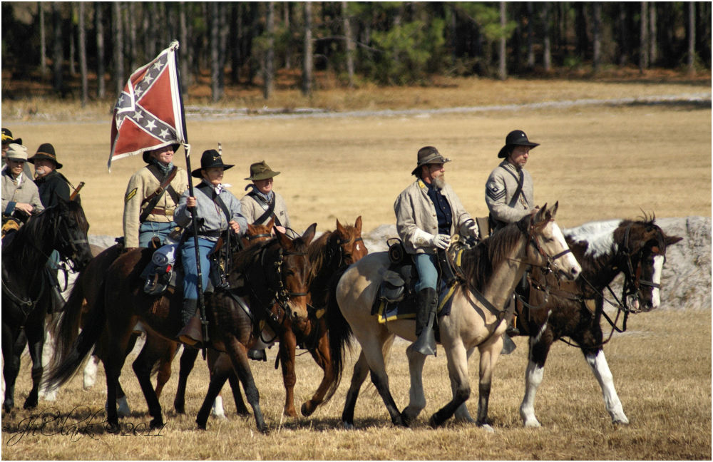 Notice who is carrying the Battle Flag...