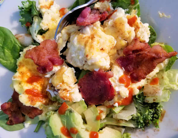 Scrambled eggs on salad...