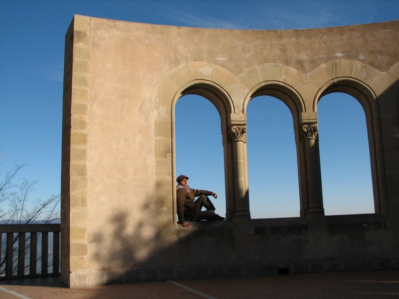 A man setting in an arch