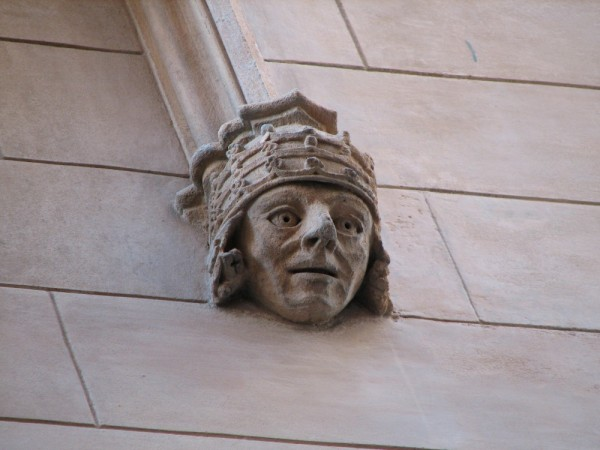 A face sculptured on the face of a building