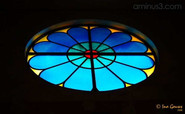 stained glass window in yellow and blue