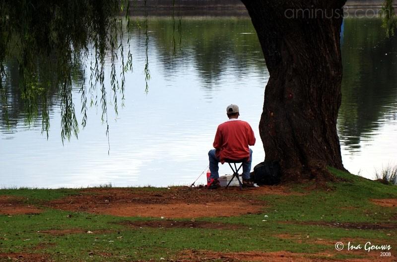 Man fishing at dam