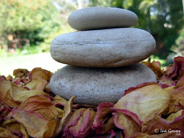 Stacked pebbles surrounded by rose pebbles
