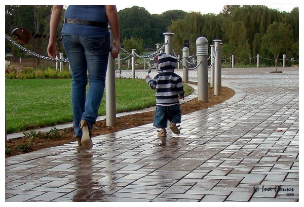 Toddler running away from his mom