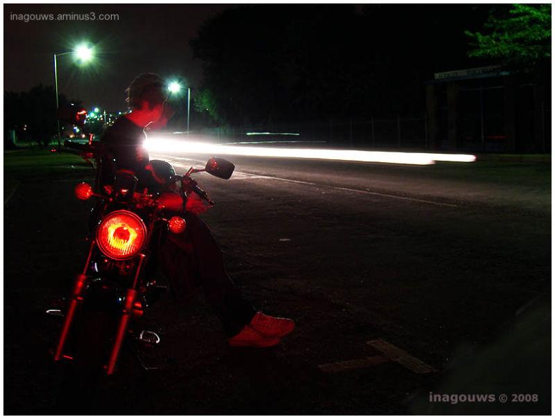 Nightshot of teenanger on bike