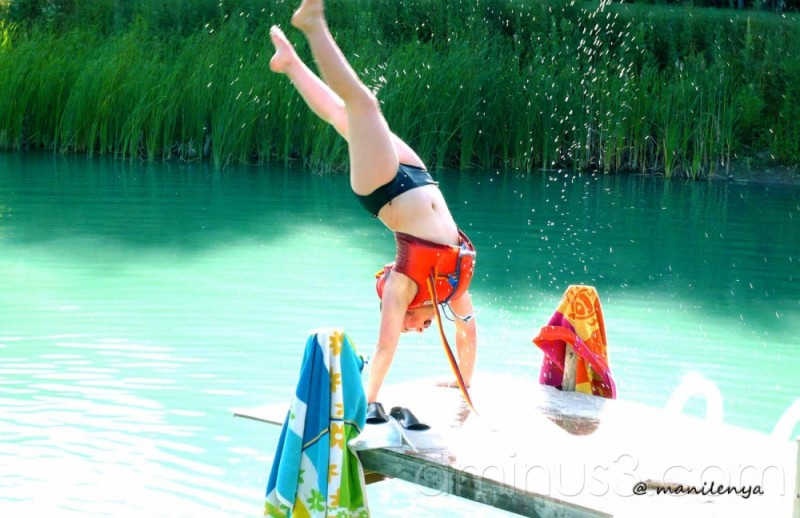 miranda doing her gymnastic stunt in the pond