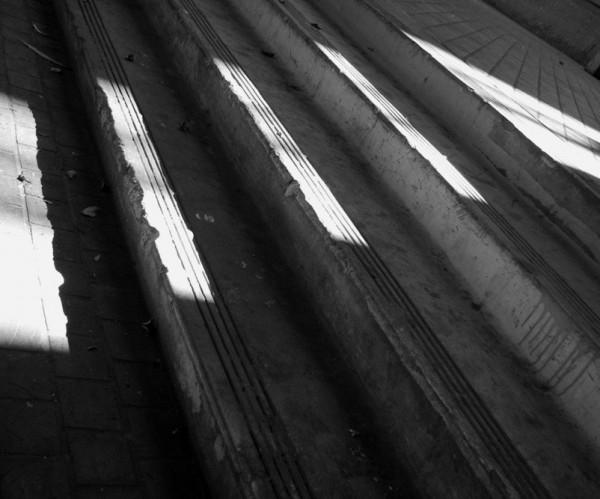 Shaft of morning light across steps below 4th st.