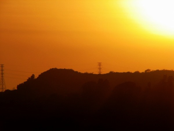 sunset over hollywood hills in silhouette