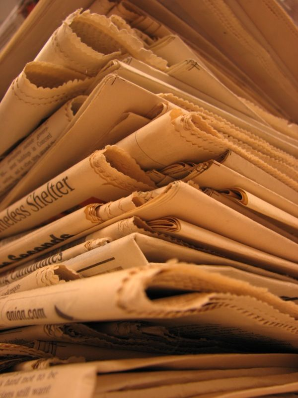 closeup on stack of newspapers