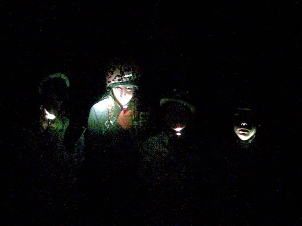 Children explore lava tubes in the Mojave Desert.