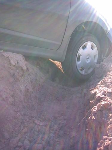 Maciek's car gets stuck in a ditch.