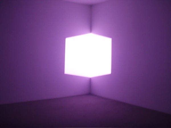 Purple polyhedron floating in space.