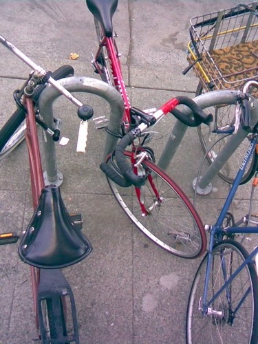 Bicycles parked on a sidewalk in Oakland, Calif.