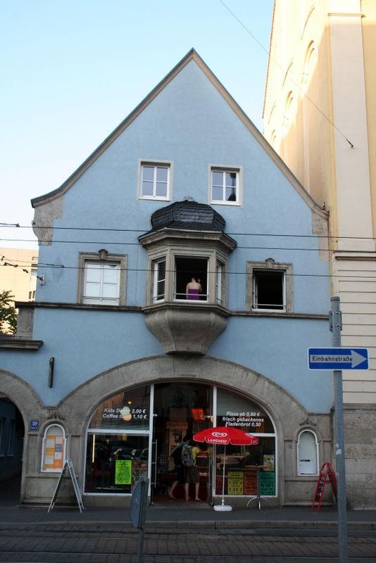 Girl on a window in a street house of Würzburg