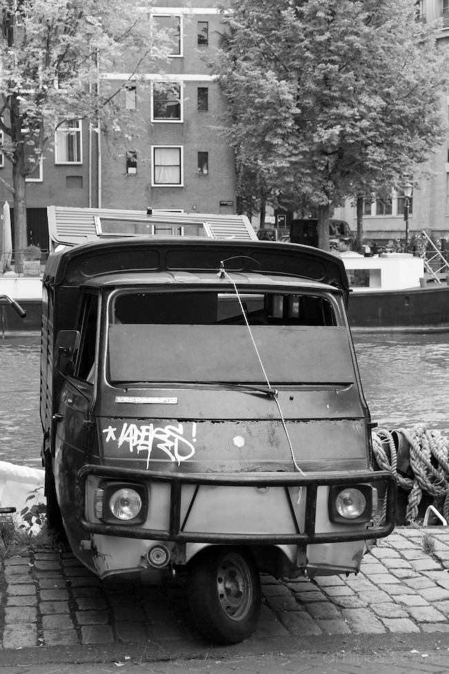 Old van on an Amsterdam canal
