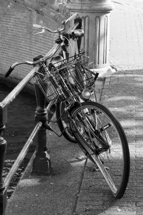 A black and white of a broken bike in Amsterdam