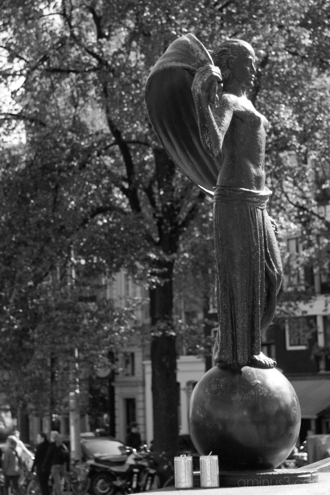 Female statue in the city of Amsterdam