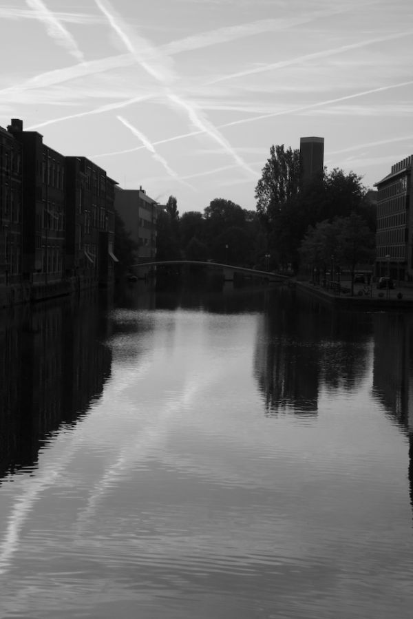 A sunrise over an Amsterdam canal