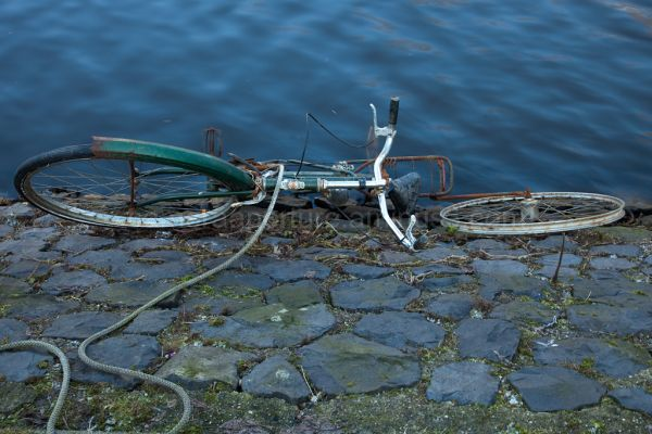 Bike on the side of the canal