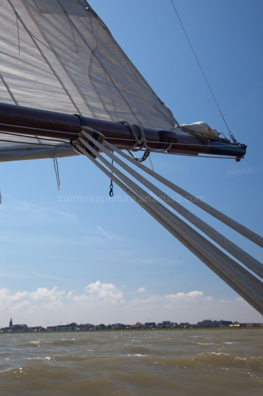 The sail and boom of the boat.