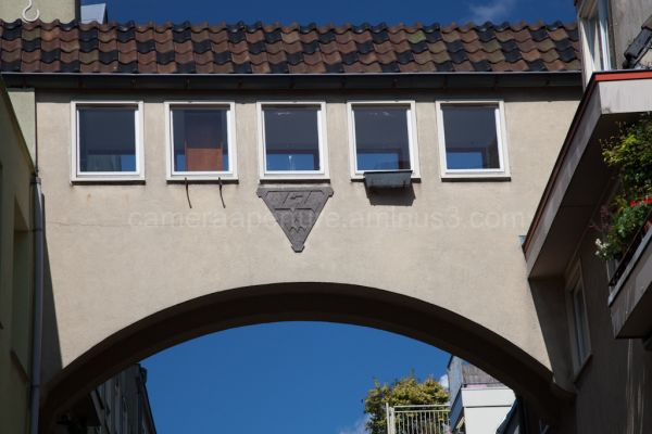 A building arching over the street.