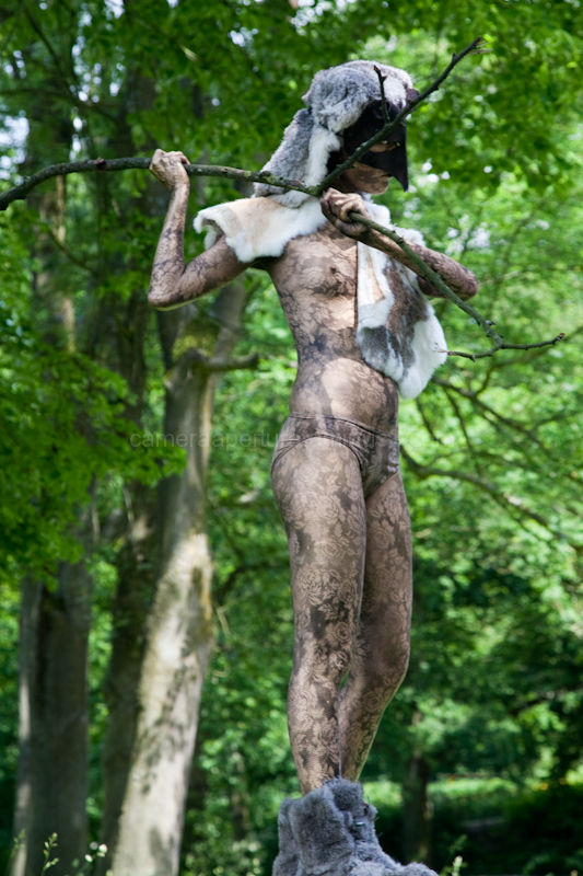 living statue with a stick