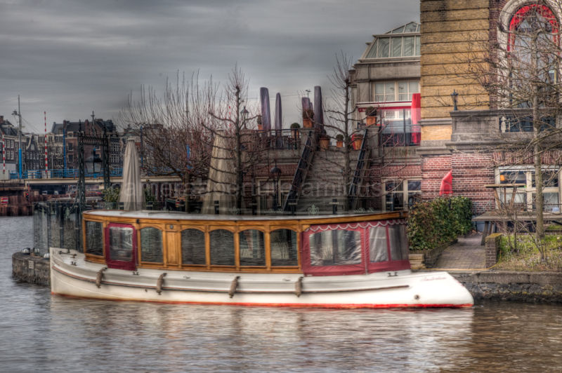 Tourist boat on the Amstel river in Amsterdam