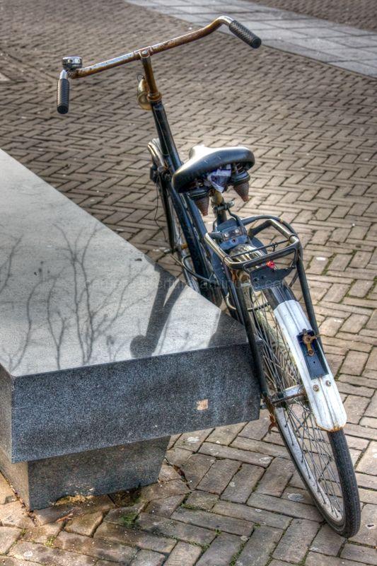 Bike beside a bench in Amsterdam