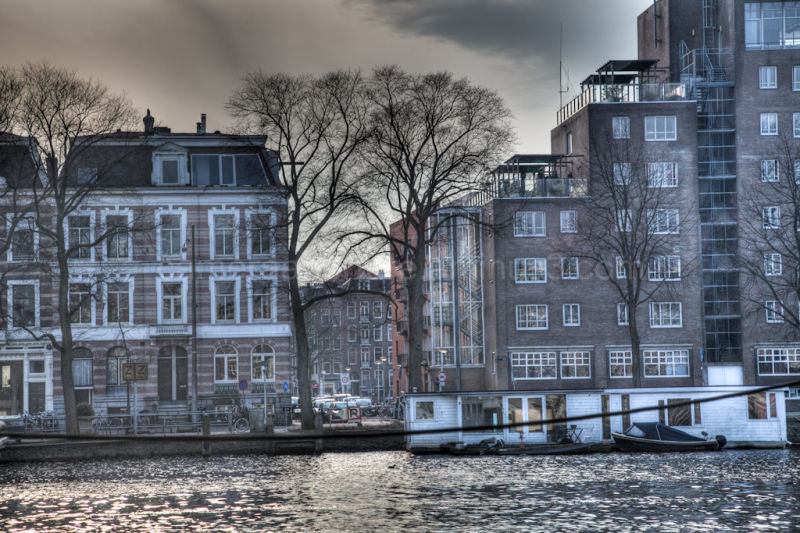 Buildings on the Amstel river bank in Amsterdam