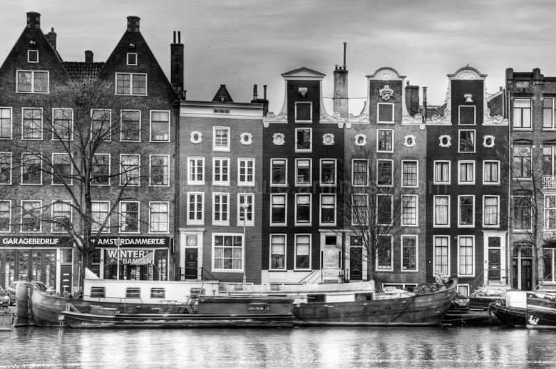 Houses on the Amstel river in Amsterdam